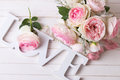 Sweet Pink Roses Flowers  And Word Love On White Painted Wooden Stock Photography - 62694152