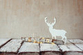 Old Tree Log With Fairy Christmas Lights And Reindeer On Wooden Table.selective Focus Stock Photos - 62694593