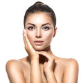 Beautiful Spa Brunette Woman Touching Her Face Royalty Free Stock Photo - 62696195