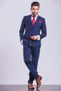 Business Man Posing Standing Legs Crossed With Hand In Pocket Royalty Free Stock Image - 62721676
