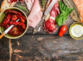 Italian Meat Plate With Bread And Antipasti On Rustic Wooden Background, Top View Royalty Free Stock Photos - 62722448