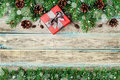 Christmas Background With Gift Box, Fir Branch And Conifer Cone On Wooden Rustic Board, Festive Snow Effect, Christmas Frame Stock Image - 62731051