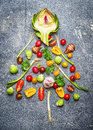 Christmas Tree Made of Fresh Vegetables On Gray Rustic Bac Stock Images - 62733874