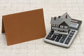 A Gray House, Brown Card And Calculator On Stone Background Royalty Free Stock Photo - 62736545