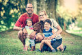 Happy Interracial Family Is Enjoying A Day In The Park Stock Photos - 62740153