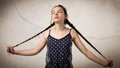 Beautiful Teenage Girl With Plaits And Onesie Royalty Free Stock Photo - 62751625