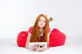 Pensive Redhead Young Woman Using Tablet Stock Photos - 62752693