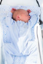 Newborn Baby Sleeping In White Stroller Stock Photos - 62759093