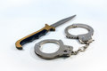 Knife And Handcuffs Stock Photos - 62762873