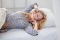 Beautiful Blonde Young Woman Sleeping In Bed Stock Image - 62780791