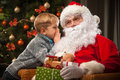 Santa Claus And A Little Boy Stock Photo - 62797110