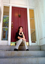 Young Woman On City Apartment Steps Royalty Free Stock Photography - 6283757