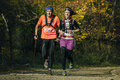 Running Along An Old Man And Young Woman In Autumn Forest Royalty Free Stock Image - 62837686