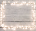 Christmas Lights On White Painted Wooden Background With Copy Sp Stock Image - 62840261