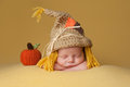 Newborn Baby Boy Wearing A Scarecrow Hat Stock Photography - 62843242