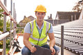 Builder Working On Roof Of New Building Stock Photo - 62849910
