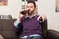 Man Watching TV And Drinking Beer Stock Image - 62897541