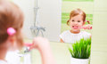 Happy Child Girl Brushing Her Teeth Toothbrushes In Bathroom Stock Photography - 62897552