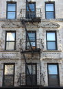 Fire Escape Steel Ladder On White Apartment Building Facade Royalty Free Stock Image - 62900326