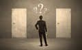 Businessman Standing In Front Of Doors Royalty Free Stock Image - 62903646