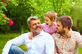 Portrait Of Happy Grandpa, Father And Son In Spring Garden Royalty Free Stock Photos - 62905158