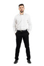 Confident Elegant Business Man With Hands In Pockets Looking At Camera. Royalty Free Stock Photo - 62924615