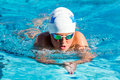 Teen Boy Swimming Breaststroke. Stock Photography - 62934442