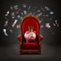 Moneybox Pig In Crown On The Royal Throne Royalty Free Stock Photo - 62960495