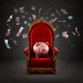 Moneybox Pig On The Royal Throne Stock Photos - 62960713
