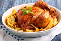 Roast Chicken And Potato Chips Stock Photography - 62962522