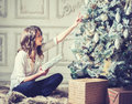 New Year Woman Portrait Near Christmas Tree With Gift Boxes Royalty Free Stock Photo - 62971755