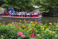 San Antonio River Boat Tour With Flowers Stock Photo - 62988020