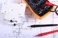 Multimeter And Electric Fuse On Construction Drawing Stock Image - 62993921