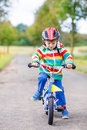 Cute Child Learning To Ride A Bike Royalty Free Stock Image - 62996096