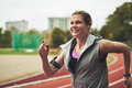 Smiling Woman Running On Track Field Stock Photos - 62997813