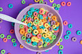 Colorful Cereal In Bowl On A Purple Background Stock Photography - 63002052
