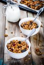 Homemade Granola With Raisins And Nuts In Two White Bowls Stock Photography - 63013082