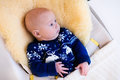 Little Baby In Nordic Sweater On Sheepskin Muff Stock Photography - 63017052