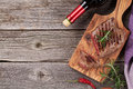 Grilled Beef Steak With Rosemary, Salt And Pepper And Wine Stock Photos - 63019133
