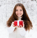Young Girl With Small Red Gift Box Standing In Winter Forest Stock Photo - 63033870