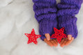 Woman Hands In Light Teal Knitted Mittens Are Holding Red Stars Stock Photo - 63059180
