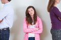 Teenage Girl Standing Between Parents Not Speaking To Each Other Royalty Free Stock Photos - 63069408