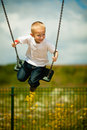 Little Blonde Boy Child Having Fun On A Swing Outdoor Stock Image - 63086091