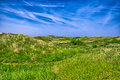 Background Image Of Lush Grass Field Under Blue Sky North Sea, Z Stock Image - 63104381