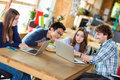 Group Of Young People Working Together At Table Using Laptops Royalty Free Stock Image - 63104726