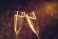 Two Elegant Champagne Glasses Making Toast Royalty Free Stock Image - 63104916
