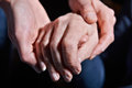 Young Woman Holding Old Woman S Hand Against Black Background Stock Photography - 63123922