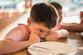 Little Boy Waiting For Food In The Restuarant Royalty Free Stock Image - 63139966
