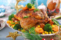 Roasted Chicken With Vegetables On Christmas Table Royalty Free Stock Images - 63146209