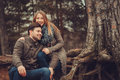 Happy Loving Couple On The Cozy Walk In Autumn Forest Stock Photo - 63146390